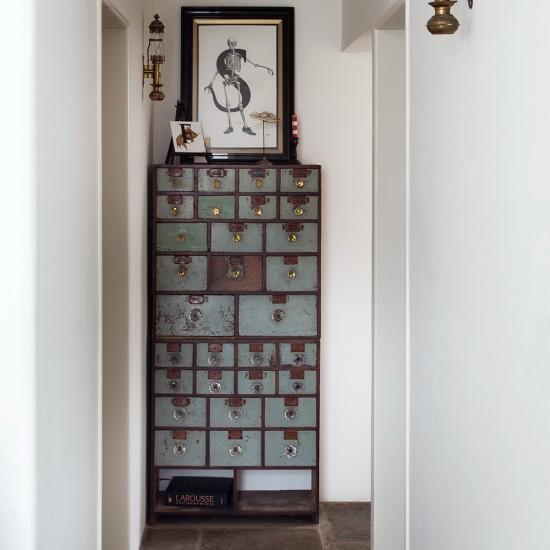 Narrow White Hallway With Industrial Style Storage Unit