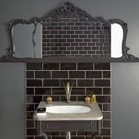 Modern black bathroom with ceramic tiles and basin
