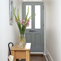 Simple but smart hallway with grey painted front door