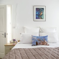 Pretty white bedroom with touches of blue and pink