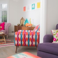 White living room with jolly mix of colourful furniture