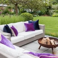 Garden patio with outdoor sofas and fire pit
