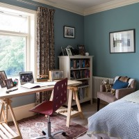 Teal bedroom with trestel desk
