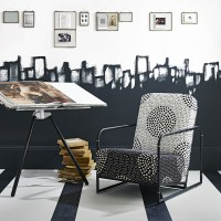 Monochrome home office with armchair and painterly wall