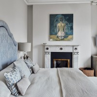 Classic bedroom with pale walls and fireplace