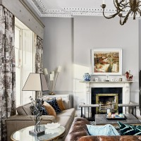 Pale grey living room with patterned curtains and period traditional fireplace