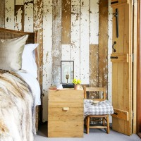 Country bedroom with reclaimed wood feature wall