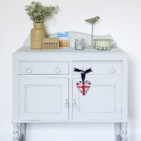 Painted bedroom cupboard with folk-art accessories