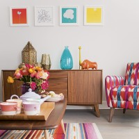 Modern living room with retro sideboard and pink and blue accents