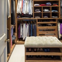 Walk-in wardrobe with made-to-measure storage and footstool