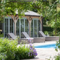 Summer pool house with terrace and sun loungers