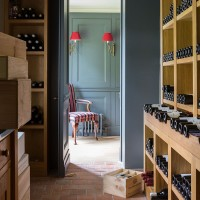 Grey-blue wine cellar with wooden storage units