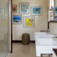 Modern shower room with twin basins and colourful wall art