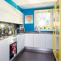 Contemporary handleless kitchen with blue feature walls