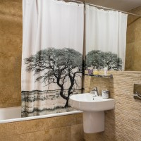 Warm and welcoming bathroom with picture shower curtain