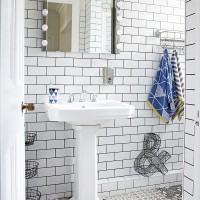 Monochrome bathroom with metro tiled walls and dressing room style mirror