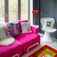 Modern living room with bright pink fun sofa