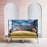 Painterly living room with dusky pink wallpaper and patterned sofa