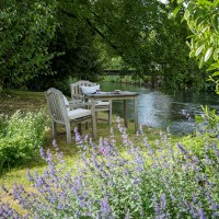 Country garden with wooden table and chairs