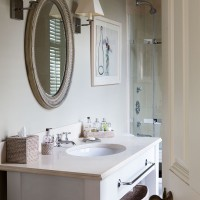 Traditional bathroom with vanity unit and wall mirror