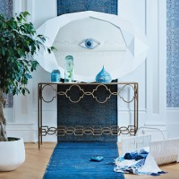 Turkish-inspired hallway with elegant console table and geometric mirror