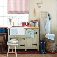 Country utility room with rustic butler sink and unit