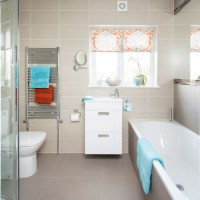 Neutral bathroom with orange and blue accents