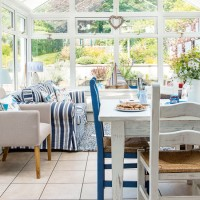 Feel-good conservatory with smart blue and white theme