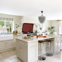 Glamorous modern country kitchen with red splashback