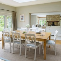 Light bright dining room with white-painted chairs