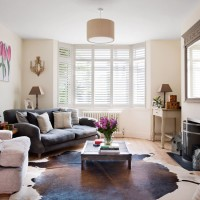 Modern living room in toning neturals and hits of pink
