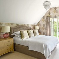Attic-space bedroom with pretty gable-end wallpaper