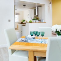 Smart kitchen-diner with upholstered chairs and pretty glassware