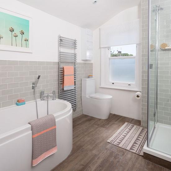 Grey and white bathroom accessorised in pretty peach housetohome co