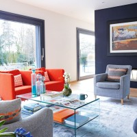 Chic modern living room with picture windows and orange sofa