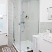 Stylish shower with metro tiled walls and wood-effect tiles