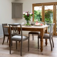 Traditional neutral dining space with toning wood finishes