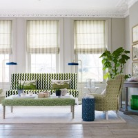 Super-smart living room with toning greens of multi pattern