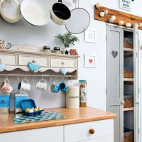 Country kitchen with dresser-like cupboard and shelving
