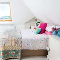 Cosy attic-space bedroom with vintage-style bedding