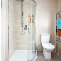 Chic netural shower room with wall-to-wall tiles