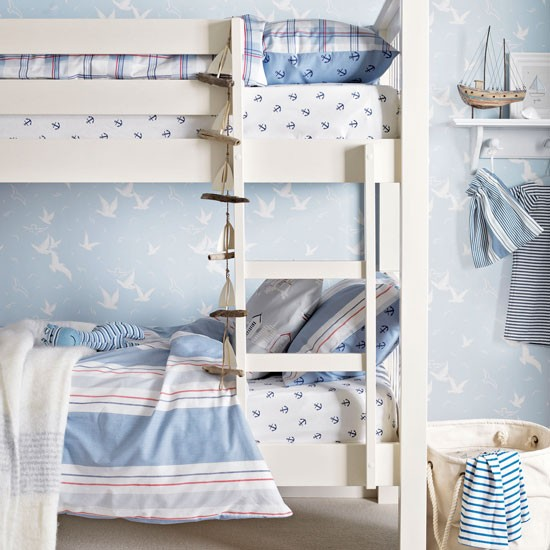 Nautical childs room with bunk bed and maritime wallpaper