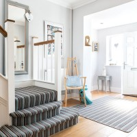 Large open hallway with grey striped stair runner