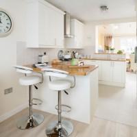 White modern kitchen with mini peninsula