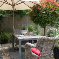 Pretty courtyard garden with sheltered seating area
