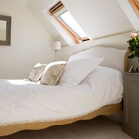 Cosy attic-space bedroom in snow white