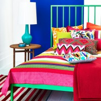 Carnival-themed bedroom with vibrant accessories and furniture