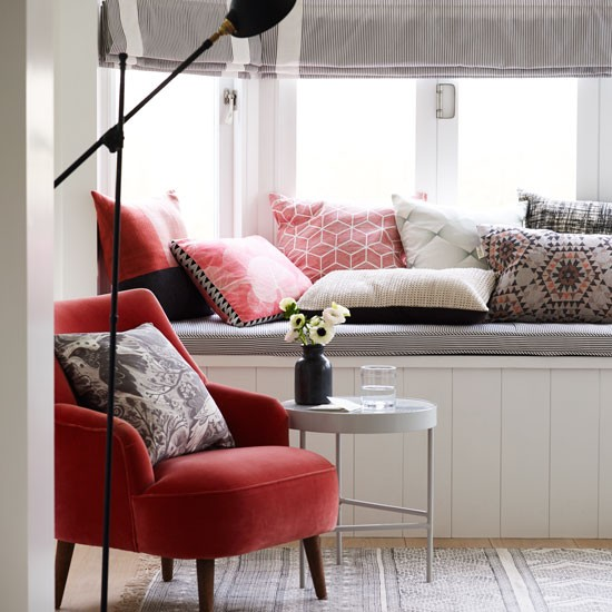 modern country living room with bench seating and floor lamp