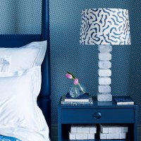Blue modern bedroom with oversized lamp and patterned lampshade