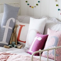 Child's room with cute letter motif cushions